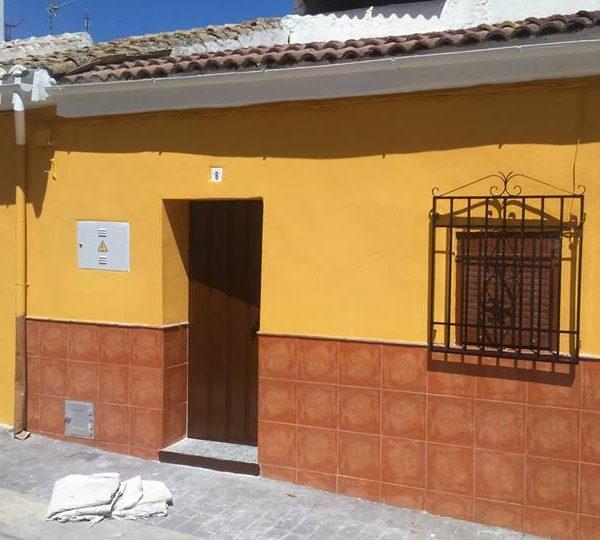 Revocado y pintura elástomera en fachada